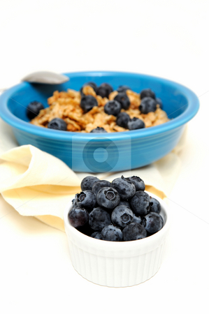 Blueberries And Cereal stock photo, Bowl of cold breakfast cereal with fresh blueberries on a white background by Lynn Bendickson