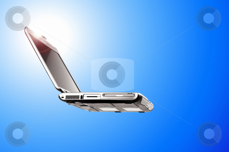 Laptop on blue stock photo, Laptop flying over a beautiful blue sky by ikostudio