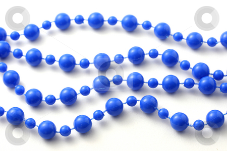 Blue beads isolated stock photo, Blue beaded necklace isolated on pure white. by Claudiu Badea