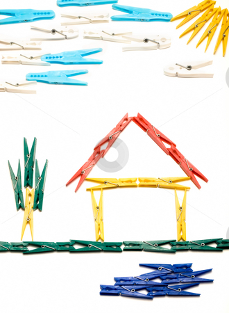 Clothespin house stock photo, House and surrounding  outline made from colored clothes pegs, like children's drawings. by Sinisa Botas