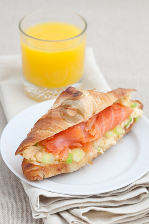 Croissant with smoked salmon and scrambled eggs stock photo, Fresh croissant with smoked salmon, scrambled eggs and garnished with spring onion by Robert Anthony