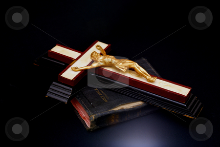 Glowing stock photo, Dynamic glowing  image of an old crucifix laying on top of an ancient leatherbound bible by Stephen Orsillo
