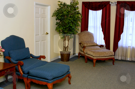 Sitting Room stock photo, Old fashioned sitting room with tree and door by Stephen Orsillo