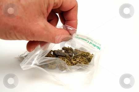 Medical Marijuana stock photo, A small plastic bag labeled medical Cannabis with dried buds of Marijuana inside used by some to treat a wide range of medical conditions by Lynn Bendickson