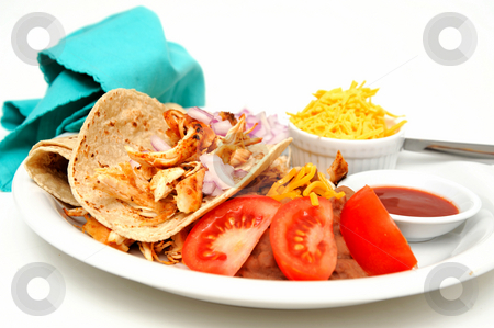 Chicken Taco stock photo, Shredded grilled spiced chicken on a white plate with fresh tortilla's, refried beans with sides of red onion, cheddar cheese and hot sauce. by Lynn Bendickson