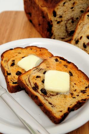 Raisin Cinnamon Toast stock photo, Raisin bread toast with melting butter on top ready to be spread by Lynn Bendickson