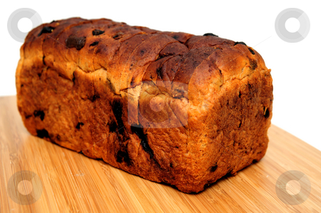 Raisin Cinnamon Bread Loaf stock photo, Loaf of sliced cinnamon raisin bread on a wooden cutting board by Lynn Bendickson