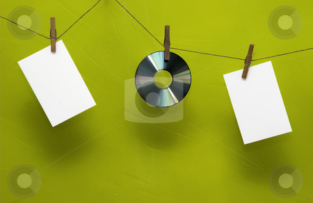 Photo concept stock photo, Photo paper and Cd drying on the rope with clothes spins by ikostudio