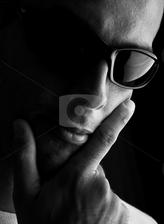 Man portrait stock photo, Man portrait with eyeglasses (focus in on the finger and glasses) by ikostudio