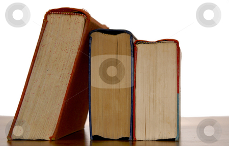 Books on edge stock photo, Three old books from the side with bindings facing up by Stephen Orsillo