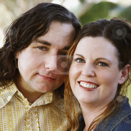 Affectionate Couple Smiling stock photo, An affectionate couple with their heads leaning into each other smile towards the camera. Square shot. by Gerard Fritz