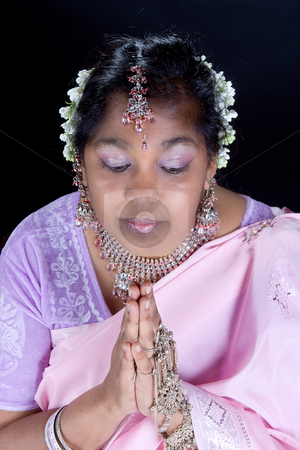 Hindu prayer stock photo, Lovely Indian woman holding her hands in prayer by Anneke