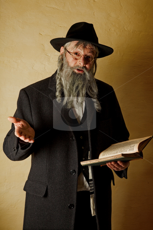 Old jew with book stock photo, Old jewish man with grey beard holding a book by Anneke