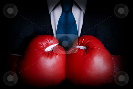 Tough stock photo, Stock image of person wearing business suit and boxing gloves by iodrakon