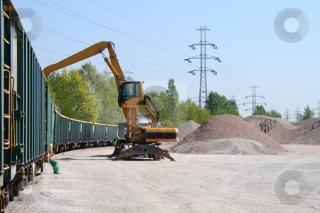Unloading scene stock photo, Excavator unloading ballast from the train by Jan Remisiewicz