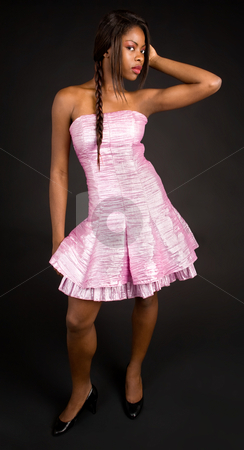 Beautiful African American Lady Looking Sideway stock photo, A beautiful young African American lady is looking sideway at the camera. by Denis Pepin