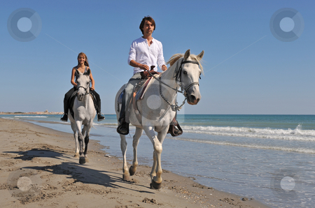 horseback riding on the beach. horseback riding on the each