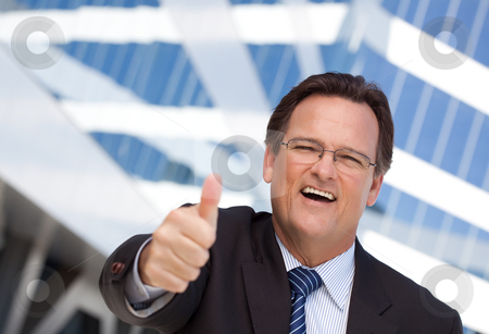 Handsome, Confident Businessman with Thumbs Up stock photo, Handsome, Confident Businessman Outside of Corporate Building with Thumbs Up. by Andy Dean