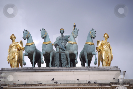 Blue and gold sculpture stock photo, Blue and gold sculpture of a carriage with four horses in paris by Olivia Neacsu