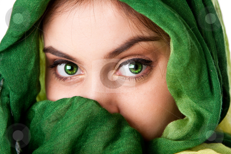 Face with green eyes and scarf stock photo, Portrait of mysterious beautiful Caucasian Hispanic Latina woman face with green penetrating eyes and green fashion scarf wrapped around head and mouth covered, isolated. by Paul Hakimata