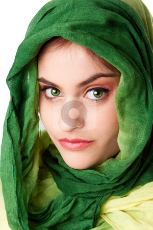 Face with green eyes and scarf stock photo, Portrait of mysterious beautiful Caucasian Hispanic Latina woman face with green penetrating eyes and green fashion scarf wrapped around head, isolated. by Paul Hakimata