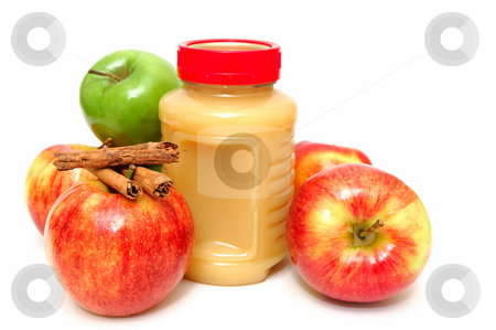 Applesauce And Apples stock photo, Fresh Apples both green and red with a jar of store bought applesauce and cinnamon sticks by Lynn Bendickson
