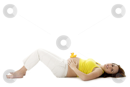 Pregnancy stock photo, Beautiful pregnant woman with a rubber duck on her tummy by ikostudio