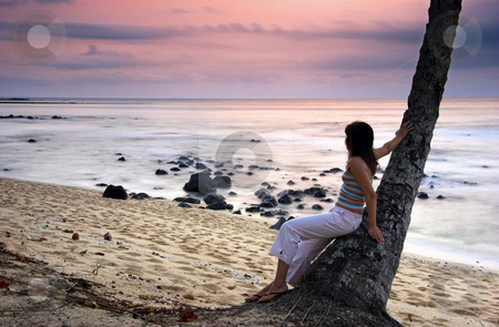 Enjoy the sunset stock photo, Beautiful woman enjoying the sunset in a beach of Sao Tom? - Equator by ikostudio