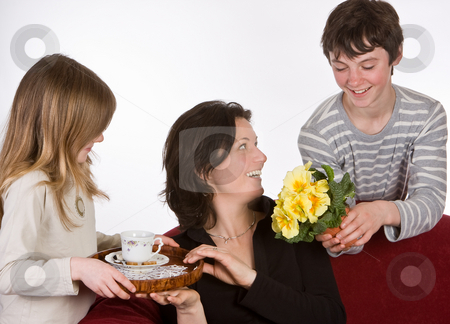 Coffee and flowers stock photo, Mother receiving coffee and flowers on mother's day by Anneke