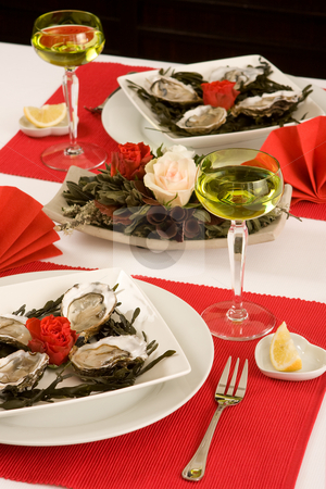 Oyster dinner stock photo, Elegant oyster dinner in red and white by Anneke