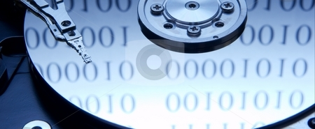 Harddisk stock photo, Internals of a hard drive with binary code reflection by P?