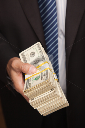 Businessman Handing Over Stack of Cash stock photo, Businessman Handing Over Stack of One Hundred Dollar Bills. by Andy Dean