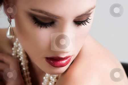 Attractive Young Woman Wearing Pearls stock photo, Attractive young woman wearing a pearl necklace and earrings. Horizontal shot. by Angela Hawkey