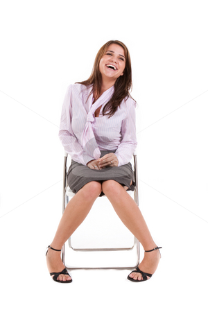 Young Business Woman Sitting Down stock photo, Young business woman sitting down and laughing. Vertically framed shot. by Angela Hawkey