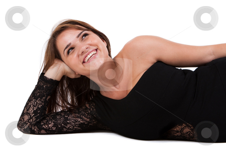 Young Female Model stock photo, Young female model wearing sexy, black dress. Horizontally framed shot. by Angela Hawkey