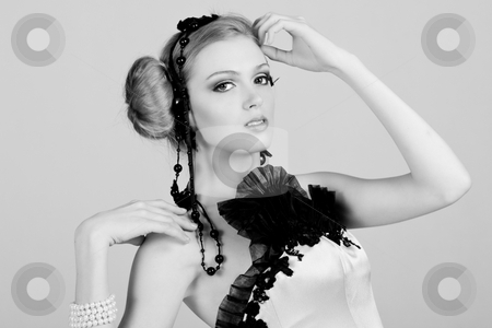 Attractive Young Woman in Black stock photo, Attractive young woman wearing black feather and pearl hair dressings. She has her hand on her head. Horizontal shot. by Angela Hawkey