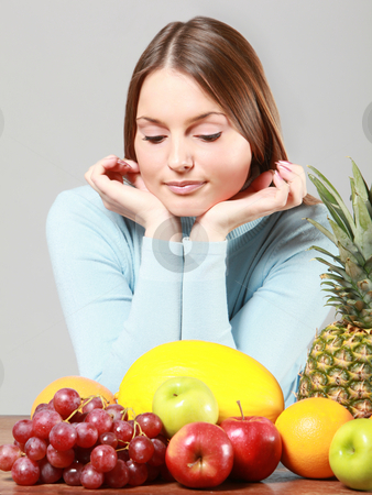 Woman with fruits stock photo, Young adult woman with various colorful fruits by Ruta Balciunaite
