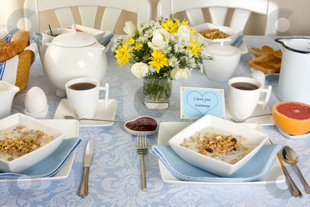 Breakfast for mommy stock photo, Mother's day breakfast table with eggs, toast and cereals by Anneke