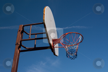 American Basketball Hoop against Blue Sky stock photo, An American red-white-and-blue Basketball Hoop Against a Blue Sky by Stacey Lynn Payne