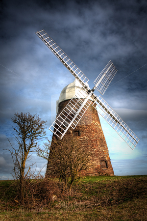 HDR Windmill stock photo, A HDR shot of a windmill in southern England against a cloudy sky. by Simon Greig
