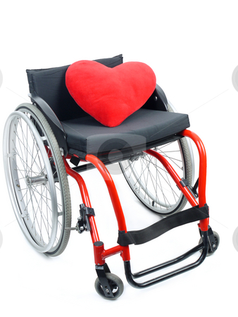Red heart and wheelchair stock photo, Red heart pillow on wheelchair isolated on white background by Roman Milert