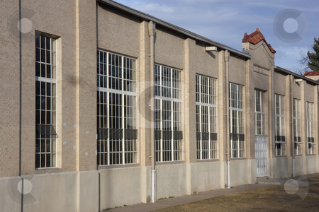 Exterior of old field house with indoor sport arena stock photo, Wall with bug windows - exterior of old field house with indoor sport arena at university campus by Marek Uliasz