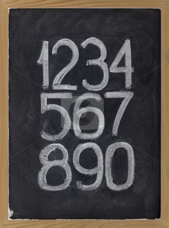 Arabic numerals on a blackboard stock photo, Ten arabic numerals handwritten with white chalk on a blackboard by Marek Uliasz