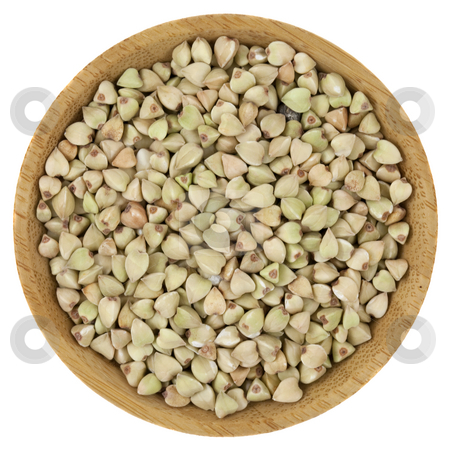 Buckwheat groats stock photo, Buckwheat groats on a small wooden bowl isolated on white by Marek Uliasz
