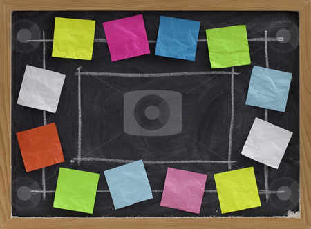 Copy space and color notes on blackboard stock photo, Copy space on blackboard with white chalk texture surrounded by colorful blank sticky notes by Marek Uliasz