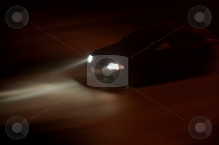 Headlights stock photo, Car going fast in the night, rays of light from the headlights by P?