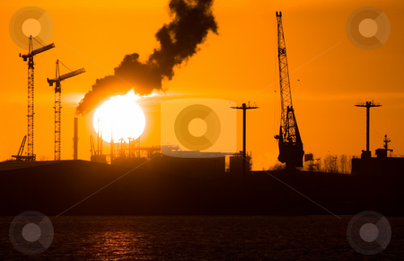 Industry silhouettes, pollution and big sun stock photo, Industry silhouettes, pollution and big yellow sun by Colette Planken-Kooij