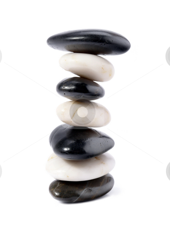 Balanced stones stock photo, Black and white stones stacked over white background by Roman Milert