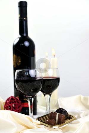Wine and chocolate stock photo, Luxury and sweet praline and chocolate with wine bottle and glasses  decoration by Benis Arapovic