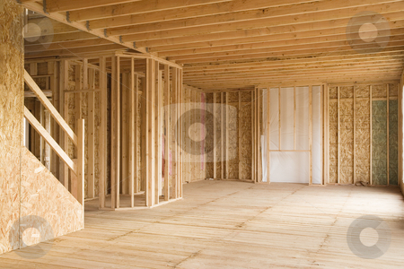 Partially Constructed House Interior stock photo, Interior of a new home under construction, with stairs to the left and an opening for a fireplace in the background. Horizontal shot. by David Papazian